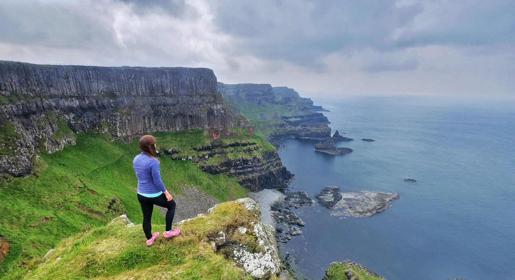 Women standing at the edge of the Causeway Cliffs